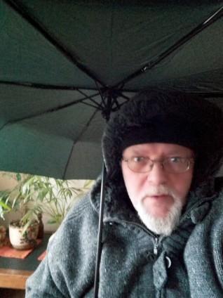 Foto von Ede samt Regenschirm