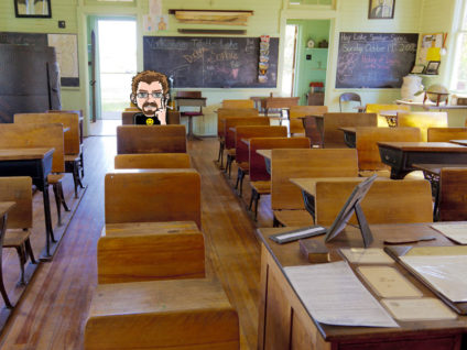 Grafik: Mein Comic-Ich in einer der letzten Bänke eines ansonsten leeren Klassenraumes